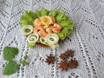 Shrimp with onion on a plate with lettuce. Cooking vegetarian healthy food with vegetables royalty free stock photos