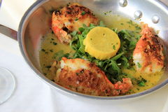 Shrimp Oreganata served in stainless steel saute p Stock Images
