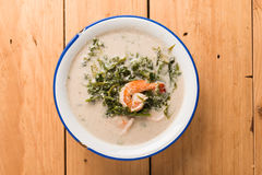 Shrimp and Paco fern (Diplazium esculentum) boil with coconut mi. Lk soup phuket thai style Royalty Free Stock Photography
