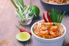 Shrimp pad thai. Famous traditional thai food shrimp pad thai, rice noodle stir-fry with prawns, tofu and vegetables on white bowl Stock Photos