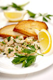 Shrimp with parsley and garlic served with croutons Stock Photos