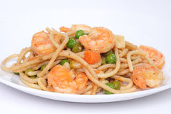 Shrimp and pasta. Plate of seafood spaghetti covered in a light tomato garlic sauce stock photo