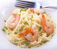 Shrimp pasta. Italian seafood pasta with spaghetti and basil Royalty Free Stock Images