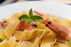SHRIMP PASTA. With basil and whole shrimp Stock Photography