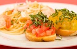 Shrimp Pasta and Bruchetta Stock Photography