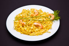 Shrimp pasta dish. On white background royalty free stock image