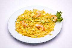 Shrimp pasta dish. On white background royalty free stock photo