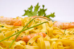 Shrimp pasta dish. On white background stock photo