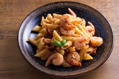Shrimp pasta with sun dried tomatoes and basil in creamy mozzarella sauce. Shrimp pasta with sun dried tomatoes and basil in creamy mozzarella sauce Royalty Free Stock Photography
