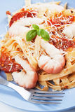 Shrimp and pasta with tomato sauce Stock Images