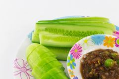 Shrimp Paste Sauce with solanum torvum and cucumber in small dis. H isolated Stock Photo