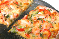 Shrimp pizza. Fresh from the oven homemade shrimp pizza topped with garden vegetables and three cheeses stock image