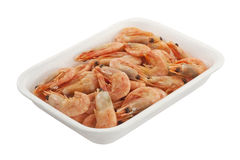 Shrimp in a plastic container isolated. A pile of shrimp in a plastic container isolated on white background Stock Photos