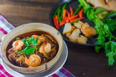 Shrimp potted with silver noodle stock photography
