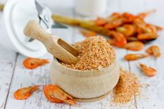 Shrimp powder, homemade spicy seasoning from dried and crushed shrimp shells for fish dishes. Shrimp powder, prawn powder - homemade spicy seasoning from dried royalty free stock image