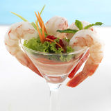 Shrimp or Prawn Cocktail.  on a White Background. Health. Y Shrimp Salad with mixed greens and tomatoes. Diet. Shrimps Royalty Free Stock Photos
