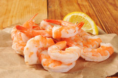 Shrimp. Prawns on butcher paper with a wedge of lemon stock image