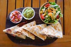 Shrimp quesadillas with guacamole and pico Royalty Free Stock Photos