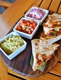 Shrimp quesadillas with guacamole and pico de gallo Stock Photos
