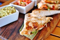 Shrimp quesadillas with guacamole and pico de gallo Stock Photography