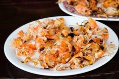 Shrimp remainder cancer after meal. On plate Stock Photography