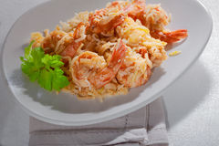 Shrimp and rice meal. Bowl of fried rice with shrimps on a plate Stock Photo