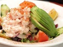 Shrimp salad. Shrimps, avocado and salmon salad on isolated background stock photo