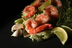 Shrimp and Salad. Large, fresh shrimp with lettuce, lemon and other ingredients to make an Asian salad royalty free stock photos