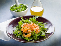 Shrimp salad with arugula. Olive oil and balsamic vinegar stock image