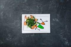Shrimp salad with avocado and arugula. stock image