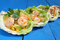 Shrimp salad on a blue table background Royalty Free Stock Image