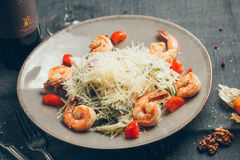 Shrimp salad. In a bowl on a wood background stock photos