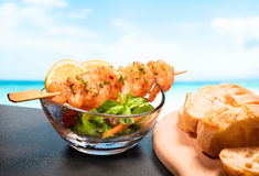 Shrimp, salad and bread Stock Images
