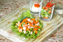Shrimp Salad. With carrot place in escarole Stock Images