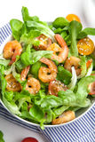 Shrimp salad with cherry tomatoes in bowl. Closeup. Healthy food concept Stock Photo