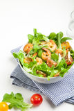Shrimp salad with cherry tomatoes in bowl. On striped napkin. White background Stock Images