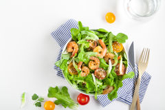 Shrimp salad with cherry tomatoes in bowl. Top view, copy space Stock Images