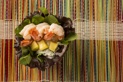 Shrimp with salad and mango in coconut Stock Photography