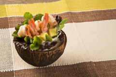 Shrimp with salad and mango in coconut Stock Image