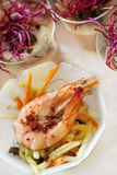 Shrimp and salad on a plate Stock Image
