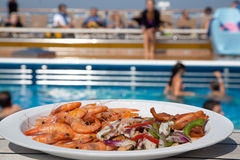 Shrimp salad in plate on deck of ship Royalty Free Stock Photo