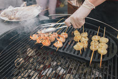 Shrimp and scallop on skewers - Street food Royalty Free Stock Images