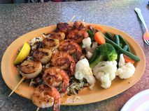 Shrimp scallops on rice and vegetables. Fish lunch n ft lauderdale Royalty Free Stock Images