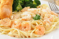 Shrimp scampi. Close up of a plate of shrimp scampi in garlic butter sauce with bread sticks Stock Photo