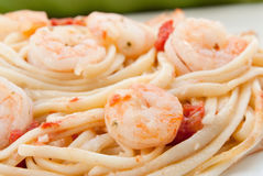 Shrimp Scampi. Close-up of shrimp scampi. Ingredients are linguini, parsley, shrimp, diced tomatoes, garlic, and butter. Shot in natural light. Selective focus Stock Photography