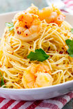Shrimp Scampi. Angel hair pasta with shrimp cooked in lemon wine sauce Stock Photography