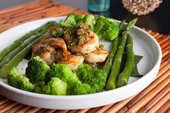 Shrimp Scampi with Asparagus. Shrimp scampi seafood dish with broccoli and asparagus Stock Image
