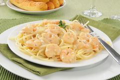 Shrimp scampi with breadsticks Stock Photography