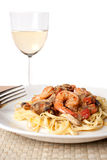 Shrimp Scampi with Linguine. A delicious shrimp scampi over linguine dish along with a glass of pinot grigio white wine Stock Photography