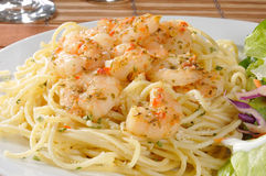 Shrimp scampi on pasta. Close up of a plate of pasta topped with shrimp scampi Stock Photography